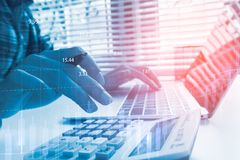 Double exposure yong businessmen calculate about cost. And doing finance at home office, Concept business and finance investment Stock Images