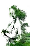 Double exposure of young beautiful girl among the leaves and trees. Portrait of attractive lady combined with photograph of tree. Creative. Effect of double royalty free illustration