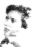 Double exposure of young beautiful girl among the leaves and trees. Portrait of attractive lady combined with photograph of tree. Creative. Effect of double stock images
