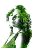 Double exposure of young beautiful girl among the leaves and trees. Portrait of attractive lady combined with photograph of tree. Stock Photo