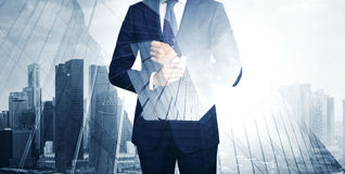 Double exposure of young business man in the stock photography
