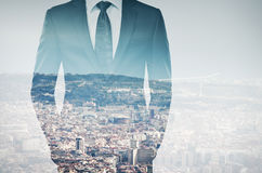 Double exposure of young businessman in black suit Stock Image