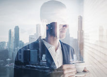 Double exposure of young businessman Stock Photo
