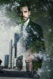 Double exposure of young confident businessman. stock photography