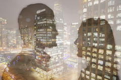 Double exposure of young couple over night cityscape Royalty Free Stock Photography