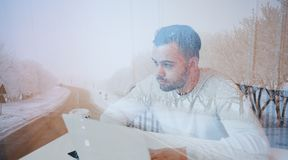 Double exposure of young pensive businessman and one road. royalty free stock photography