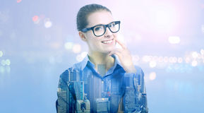 Double exposure of young professional woman in glasses Stock Photo