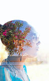 Double exposure of a young woman with colorful flowers in her hair Royalty Free Stock Image