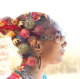 Double exposure of a young woman with colorful flowers in her hair Stock Photo