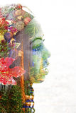 Double exposure of a young woman with colorful flowers Royalty Free Stock Images