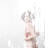 Double exposure of young woman and metropolis. Creative portrait stock photos