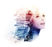 Double exposure of young woman with metropolis and doogwood. Double exposure of young woman with metropolis and dogwood flowers royalty free stock photos
