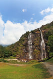 Double falls in mountains. The photo is made by a lens Fisheye Royalty Free Stock Photo