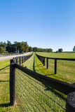 Double fence at horse farm. Royalty Free Stock Photo