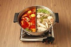 Double flavor hot pot Stock Photo