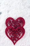 Double forme de coeur dans la neige Image stock