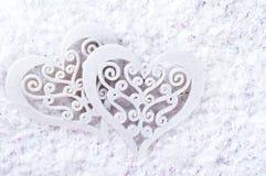 Double forme de coeur dans la neige Images stock