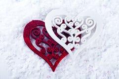 Double forme de coeur dans la neige Photos stock