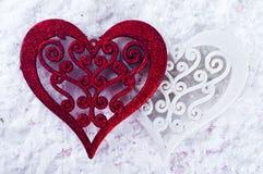 Double forme de coeur dans la neige Image libre de droits