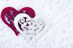 Double forme de coeur dans la neige Images libres de droits