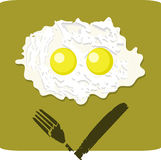 Double fried egg with grumpy face Royalty Free Stock Photography