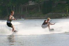 Double Fun. Teenage boys showing his skill on his wakeskate Royalty Free Stock Image