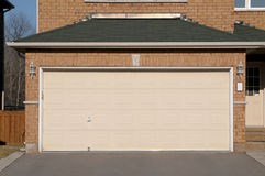 Double Garage. With a wide asphalt driveway Royalty Free Stock Photo