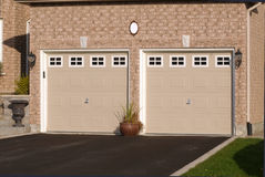 Double garage, attached to a brick house Stock Images