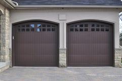 Double Garage Doors. House with double garage doors Royalty Free Stock Photo