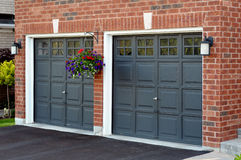 Double Garage with flower pot Stock Images
