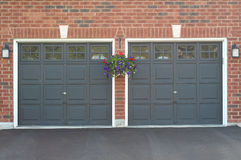 Double garage with a flower pot Royalty Free Stock Photography