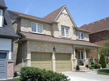 Double garage on stylish brick house. In a neighborhood of brick houses, a very stylish one Stock Image