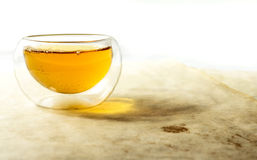 Double glass tea cup filled with green tea Stock Photography