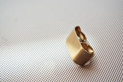 Double gold ring. Metalic background Stock Photography