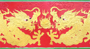 Double golden dragon painting playing fire ball on red backgroun Royalty Free Stock Photos