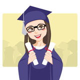 Double Graduation. Joyful brunette with eyeglasses celebrating graduation day holding two diplomas on her hands smiling Royalty Free Stock Photo