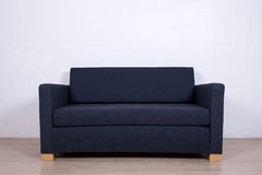 Double gray sofa in living room Royalty Free Stock Photos