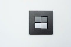 Double gray switch on the wall Royalty Free Stock Images