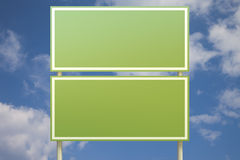 Double green sign in front of a blue sky Stock Image