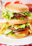 Double hamburger with cheese, lettuce and tomato Stock Photography