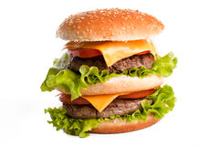 Double hamburger savoureux sur le blanc Photos libres de droits