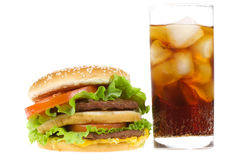 Double hamburger with vegetables and cold cola Royalty Free Stock Photo