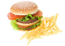 Double hamburger with vegetables and fries Royalty Free Stock Photo