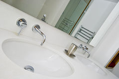 Double hand wash basin. With white sand stone surface Stock Photography