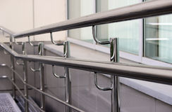 Double handrails made of stainless steel in the street. When exiting the store royalty free stock photo