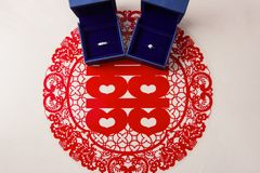Double happiness paper-cut and wedding ring Royalty Free Stock Image