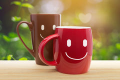 Double happy mugs in the garden Royalty Free Stock Photos