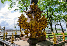 Double-headed eagle. The Arms Of Russia. The symbol of tsarist Russia. The two-headed eagle of the metal. The ancient landmark of St. Petersburg.  in the Royalty Free Stock Photo