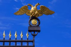 Double-headed eagle  (the emblem of Russia) on the gates of the Stock Photos