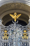 Double-headed eagle on the gates of the Hermitage Museum in St. Royalty Free Stock Image